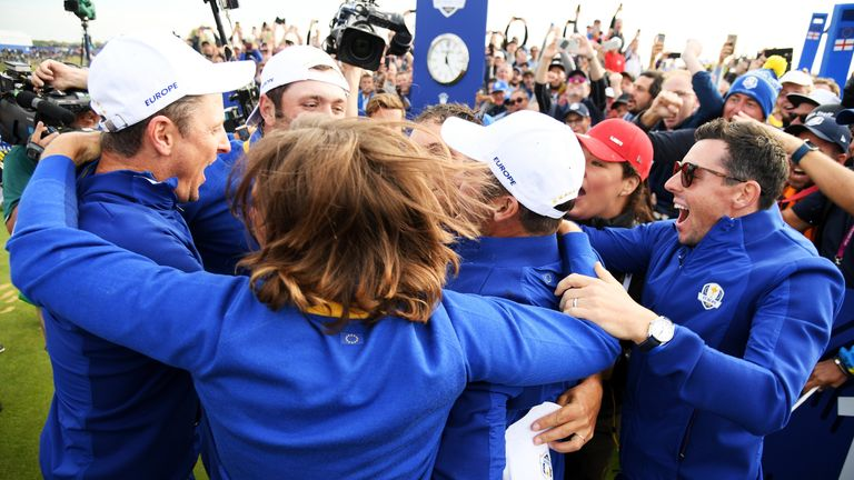 Europe's golfers, including Francesco Molinari (C) and Rory McIllroy (R) celebrate winning The Ryder Cup