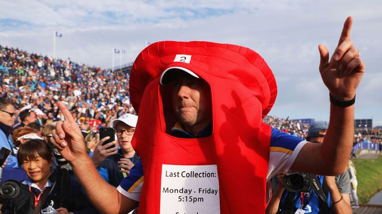 Former postman Poulter dressed up in a pillar box costume