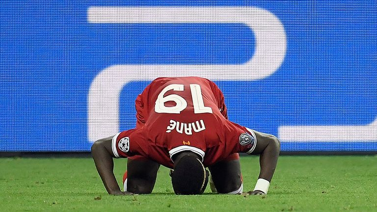 Mane prostrates himself in thanks for the goal