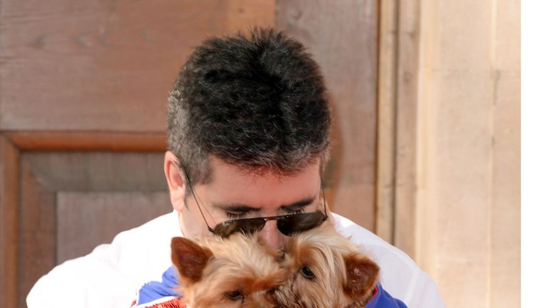 Simon Cowell with dogs Squiddly and Diddly at Britain's Got Talent photo call in 2014. Pic: David Fisher/REX/Shutterstock