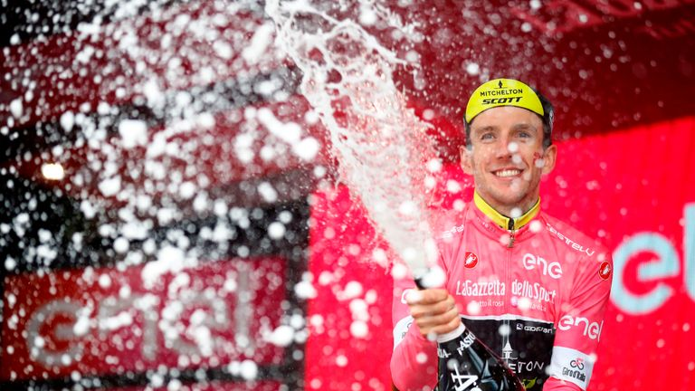 TOPSHOT - Britain's rider of team Mitchelton-Scott Simon Yates celebrates the pink jersey of the overall leader on the podium after the 16th stage, a time trial between Trento and Rovereto, during the 101st Giro d'Italia, Tour of Italy cycling race, on May 22, 2018. - (Photo by Luk Benies / AFP) (Photo credit should read LUK BENIES/AFP/Getty Images)