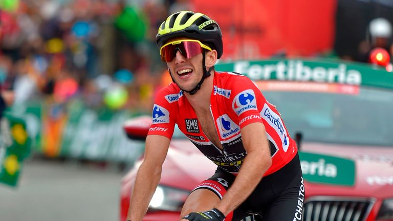 Simon Yates smiles as he crosses the line certain to win Vuelta a Espana