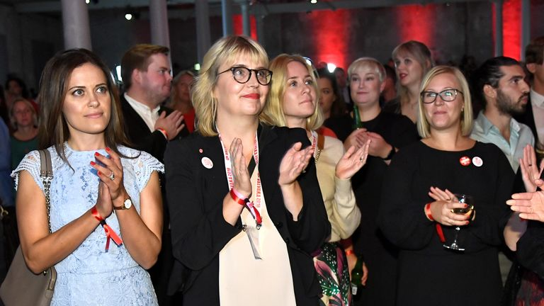 Supporters of the Social Democratic Party watch the exit polls come in