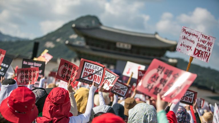SEOUL, SOUTH KOREA - AUGUST 04: (SOUTH KOREA OUT) South Korean women protest against sexism and hidden camera pornography on August 4, 2018 in Seoul, South Korea. Over 40,000 women staged a protest to urge South Korean government to come up with measures to tackle sexual abuse involving hidden cameras. The country has been in a grip of spy cameras used to capture women and sometimes men undressing, going to the toilet, or in changing rooms which are then posted online at pornographic sites. (Pho