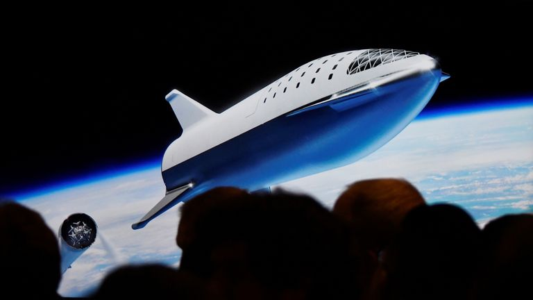 SpaceX CEO Elon Musk shows how the new BFR works during a press conference announcing the world's first private passenger scheduled to fly around the Moon aboard SpaceX's BFR launch vehicle, at the company's headquarters in Hawthorne, California
