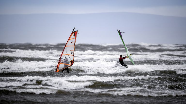Windsurfers took advantage of strong winds at Barassie beach in Troon, Scotland