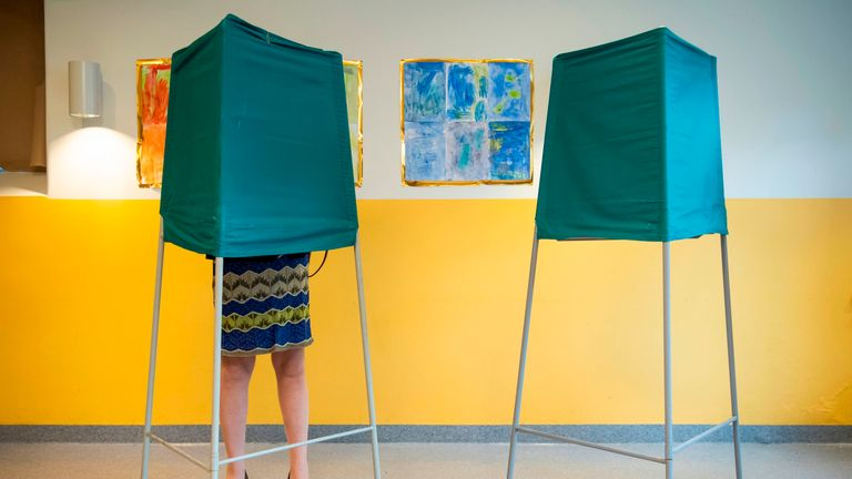 A woman votes at a polling station in Stockholm