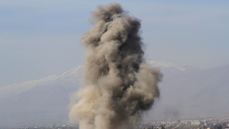 Smoke rises after what activists said was a barrel bomb dropped by government forces in Daraya, west of Damascus