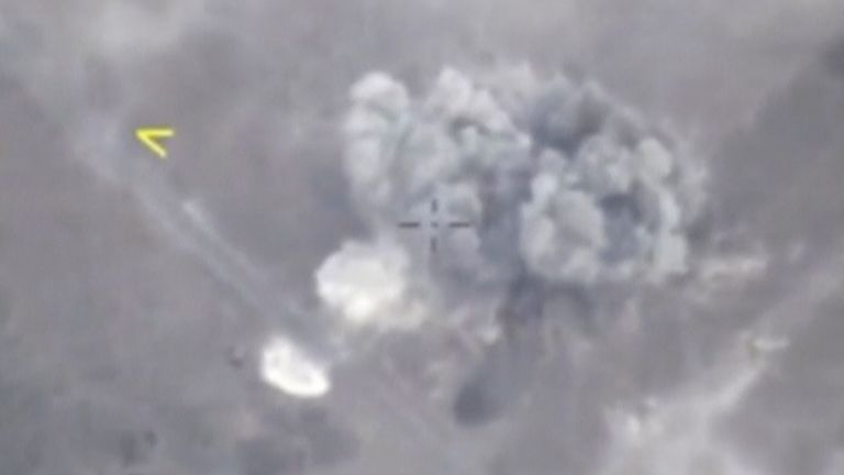 A still image taken from a video footage released by Russia's Defence Ministry shows a missile hitting...