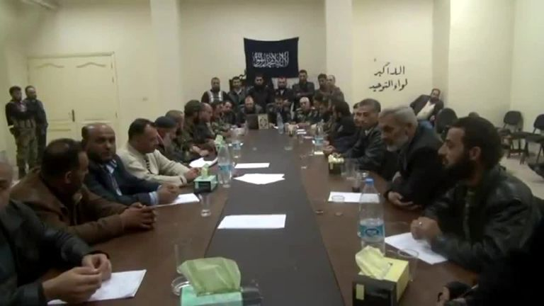 A picture said to show a group of Islamists, including al Nusra Front, rejecting Syria's opposition