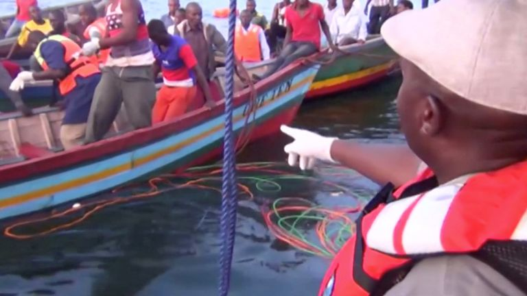 Rescue workers are seen at the scene where a ferry overturned in Lake Victoria, Tanzania