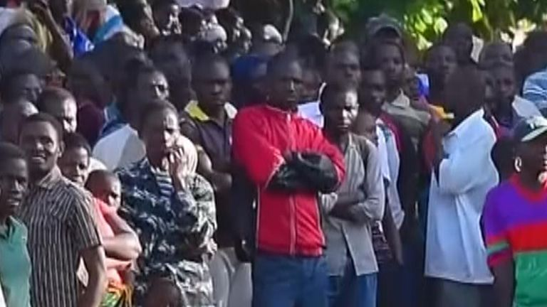 Relatives crowded on the shore waiting for news of loved ones