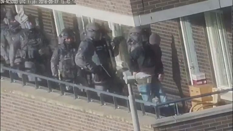 The moment police storm an apartment in Holland