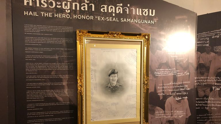 A picture of former Thai Navy Seal, Saman Gunan, who died during the mission, is on diplay