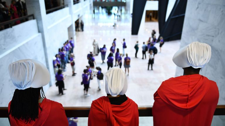 Women dressed as characters from The Handmaid's Tale