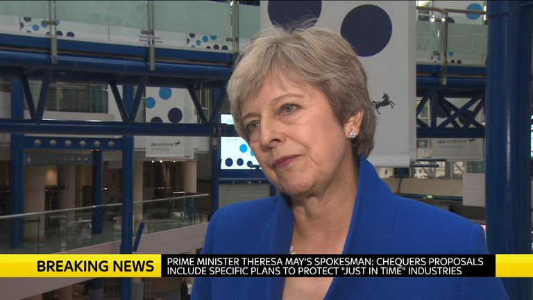 Theresa May talking to camera about Brexit.