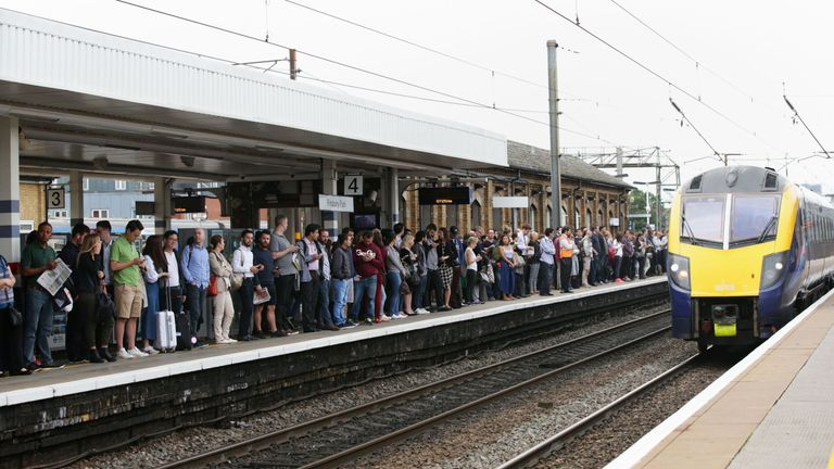 Commuters wait to board a train to Kings Cross at Finsbury Park overground station, London, as commuters and tourists face a day of travel chaos because of a strike which has closed the underground.