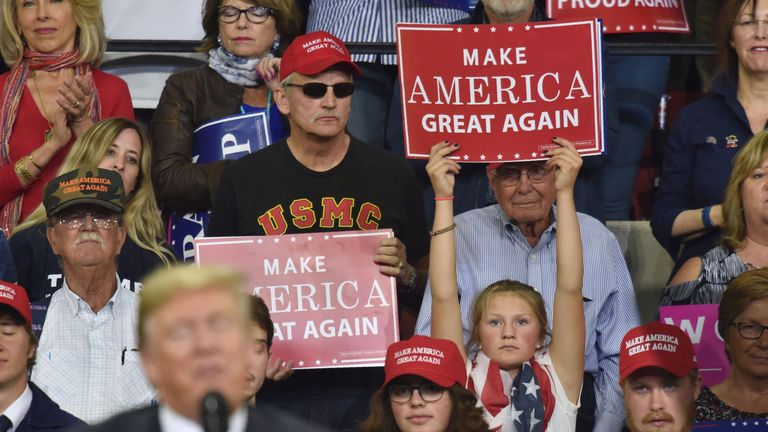 A young supporter of US President Donald Trump holds up a sign as he speaks during a 'Make America Great Again' rally in Billings, Montana on September 6, 2018