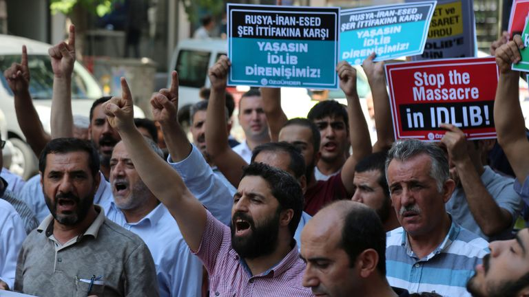 People in Diyarbakir, Turkey, protest against the Syrian government's military operation in Idlib