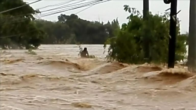 A man found stranded in raging floodwaters was rescued, as Typhoon Mangkhut hit the Philippines and Hong Kong