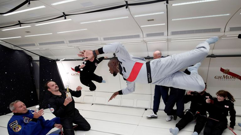 "Retired sprinter Usain Bolt, French astronaut Jean-Francois Clervoy, CEO of Novespace and French Interior designer Octave de Gaulle who designed a bottle of ""Mumm Grand Cordon Stellar"" champagne enjoy zero gravity conditions during a flight in a specially modified Airbus Zero-G plane above Reims, France, September 12, 2018."
