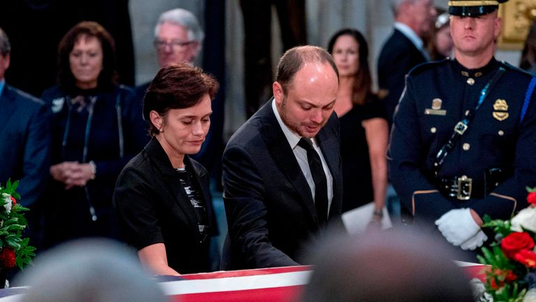 Vladimir Kara-Murza and his wife Yevgenia touch the casket of the late US Senator John McCain in the Rotunda of the US Capitol August 31, 2018 in Washington, DC. (Photo by Andrew Harnik / POOL / AFP) (Photo credit should read ANDREW HARNIK/AFP/Getty Images)