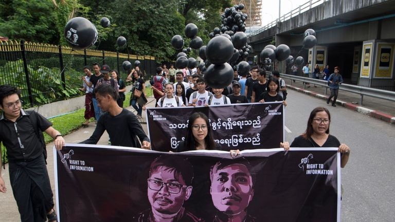 Supporters of detained Myanmar journalists Wa Lone and Kyaw Soe Oo march during a rally demanding for their release