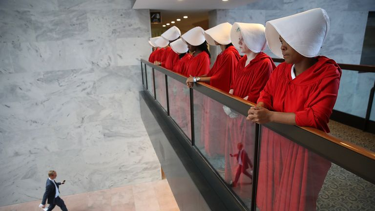 Women protest - dressed in costumes from The Handmaid's Tale