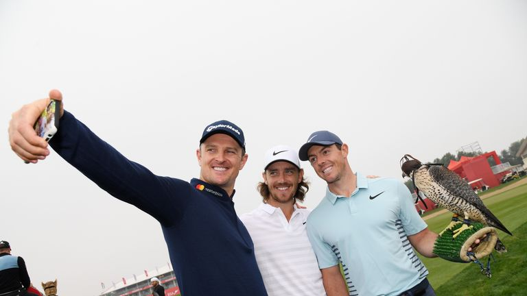 ABU DHABI, UNITED ARAB EMIRATES - JANUARY 16:  (L-R)  Justin Rose of England, Tommy Fleetwood of England and Rory McIlroy of Northern Ireland take part in a photocall for the Abu Dhabi HSBC Golf Championship at Abu Dhabi Golf Club on January 16, 2018 in Abu Dhabi, United Arab Emirates.  (Photo by Ross Kinnaird/Getty Images)