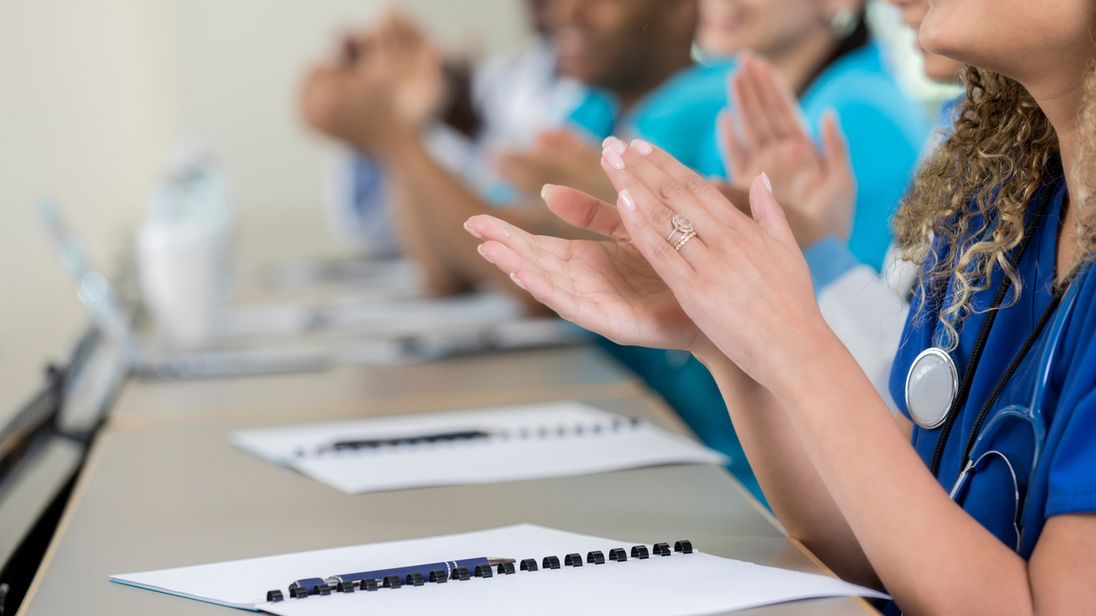University students reject clapping at events in favor of 'jazz hands'