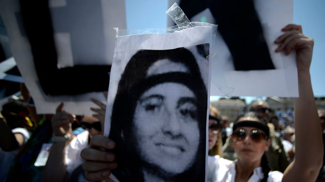 A demonstrator holds a poster of Emanuela Orlandi reading 'Missing' at a demonstration at the Vatican in 2012