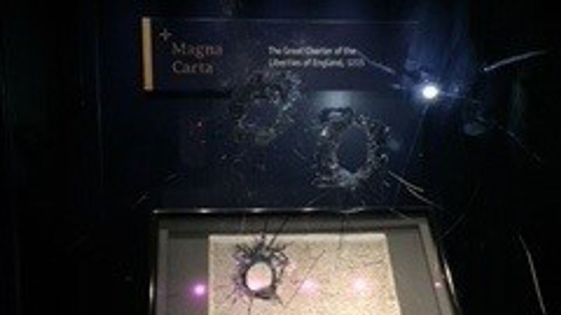 The suspect is accused of trying to smash a glass box containing the 13th century document