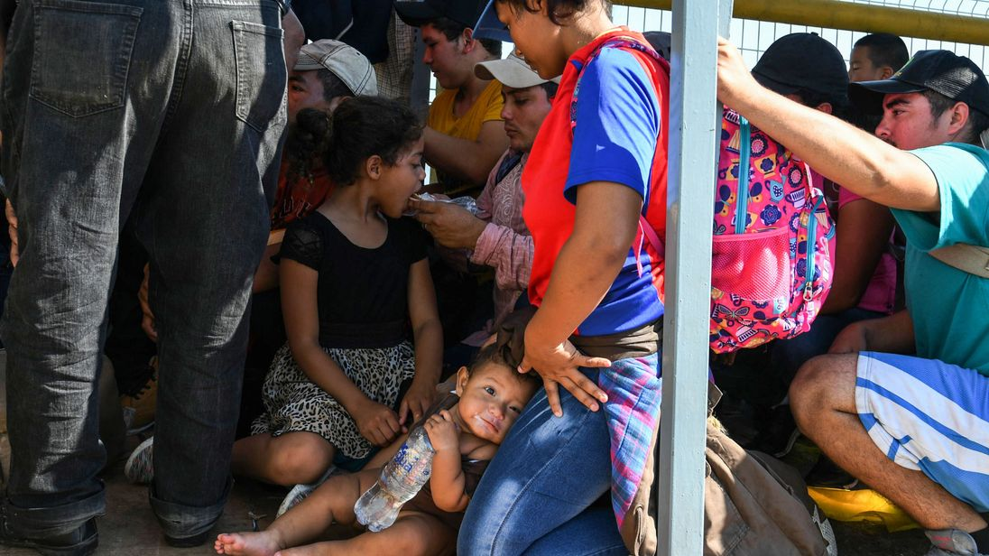 Honduran migrants wait to cross the border from Ciudad Tecun Uman Guatemala to Ciudad Hidalgo Mexico