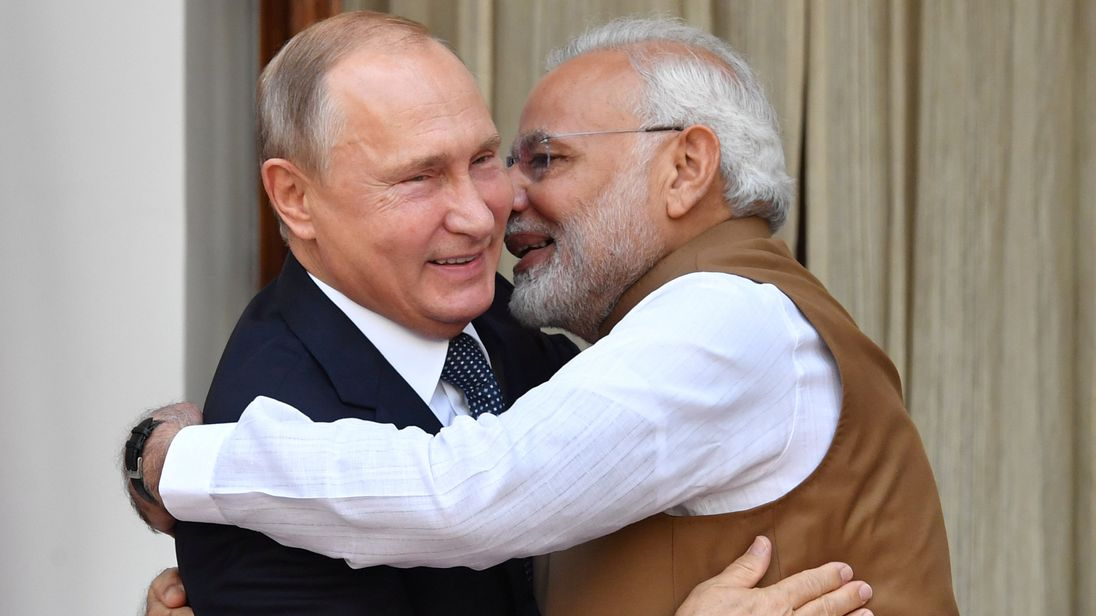 Indian Prime Minister Narendra Modi welcomes Russian President Vladimir Putin prior to their meeting at Hyderabad House in New Delhi