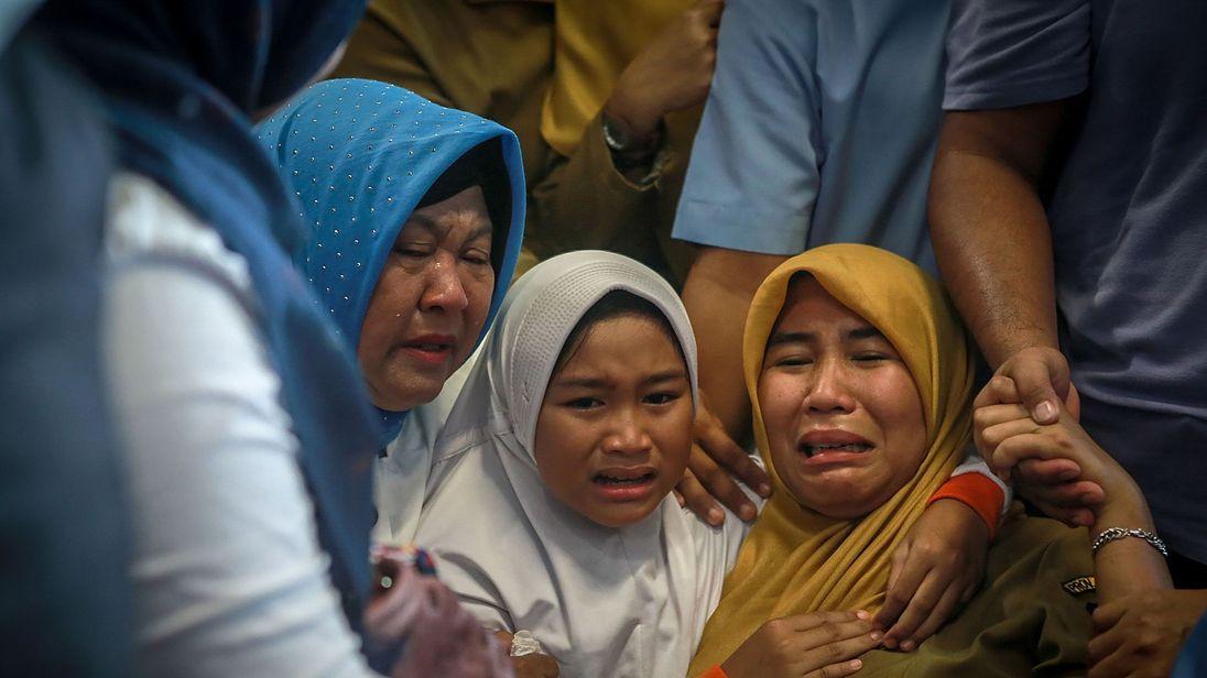 Passengers' relatives wait for news at Pangkal Pinang airport