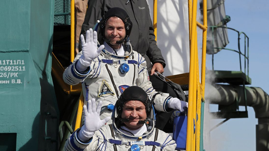 International Space Station (ISS) crew members astronaut Nick Hague of the U.S. and cosmonaut Alexey Ovchinin of Russia board the Soyuz MS-10 spacecraft