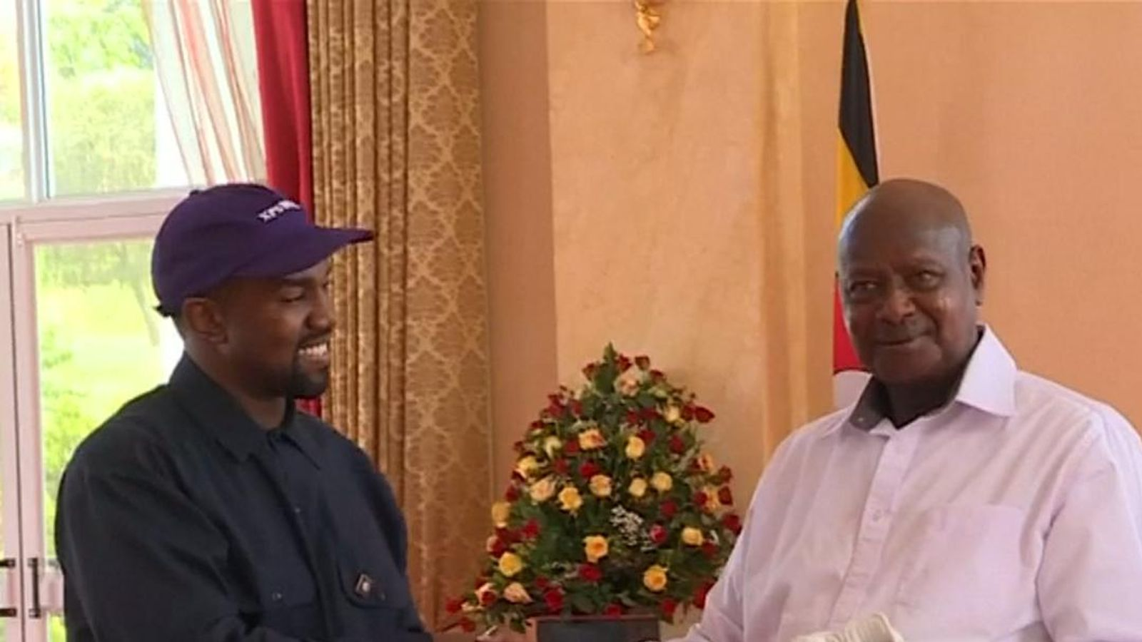 Kanye West gives Ugandan leader pair of trainers on trip to east African country