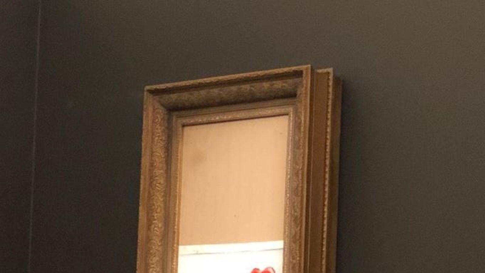Banksy painting 'self-destructs' after £1m sale