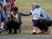Prince Harry and Meghan, Duchess of Sussex, interact with Luke Vincent, 5, after arriving at Dubbo airport