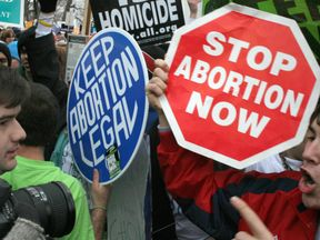 Pro-life and pro-choice protesters clash