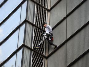 Alain Robert as he climbed the Heron Tower