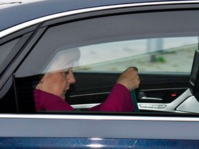 German Chancellor Angela Merkel arrives in her car to attend a leadership meeting of the CDU