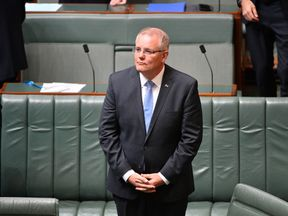 Australia's Prime Minister Scott Morrison stands before delivering the National Apology to survivors of child sexual abuse in the House of Representatives