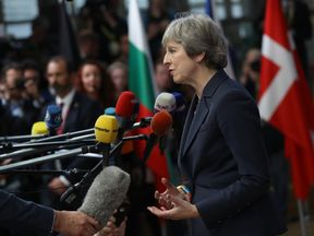 British Prime Minister Theresa May arrives for a working dinner of EU leaders on October 17, 2018 in Brussels, Belgium