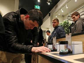 A customer looks at cannabis on display after legal recreational marijuana went on sale at a Tweed retail store in St John's, Newfoundland and Labrador, Canada
