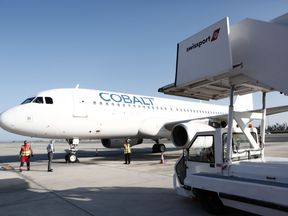 A Cobalt aeroplane taxies on the tarmac at Larnaca airport on May 30, 2016, during a blessing ceremony ahead of the launch of the new Cyprus-based airline which was postponed until July due to delays getting its commercial license.