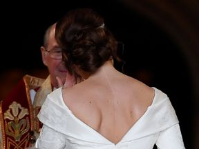 Britain's Princess Eugenie arrives at St George's Chapel for her wedding to Jack Brooksbank in Windsor...