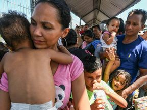 A Honduran couple and their five children who are taking part in the caravan