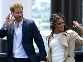 Prince Harry and Meghan arrive for a public walk at the Sydney Opera House
