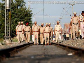 Punjab police examine the scene where the crash took place